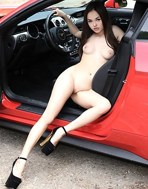 Naked girls posing with cars